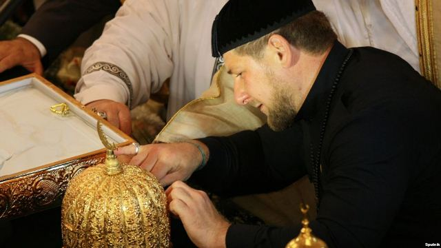 President Ramzan Kadyrov inspects a collection of relics at the Akhmad Kadyrov Mosque