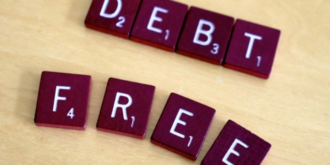 Can a person give Sadaqah while in Debt?
